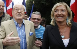 554845_jean-marie-le-pen-france-s-far-right-national-front-political-party-leader-arrives-with-his-daughter-marine-le-pen-for-a-meeting-in-cormont